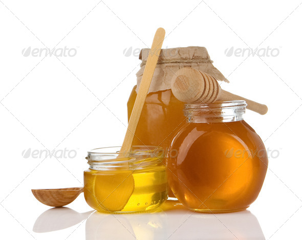 glass pot of honey, spoon and stick - Stock Photo - Images