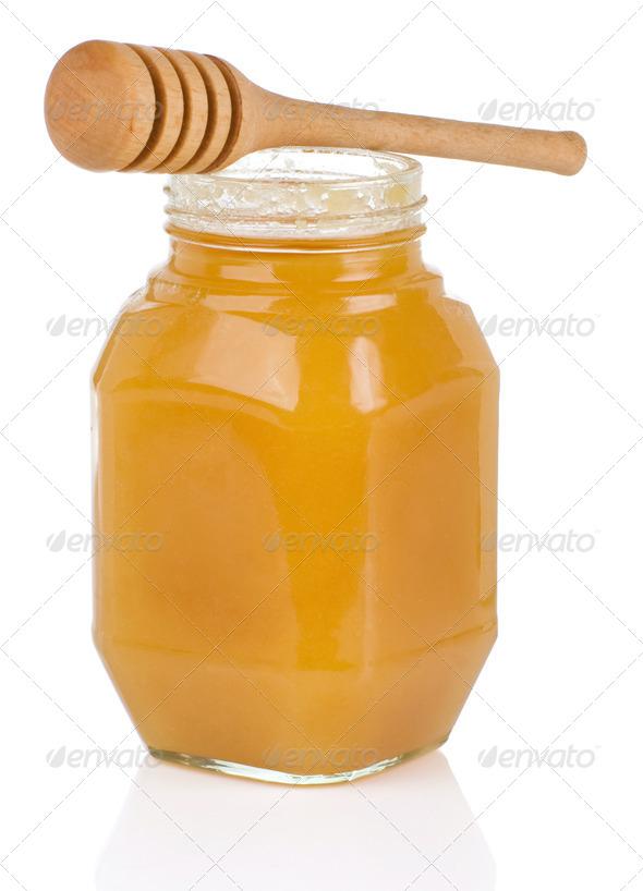 jars full of honey isolated on white - Stock Photo - Images