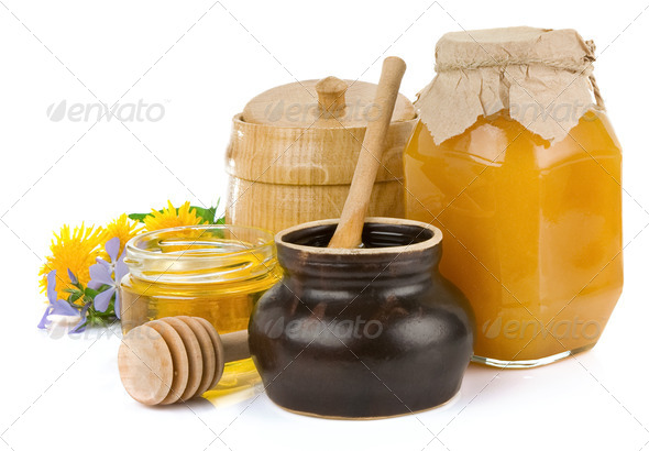 jar of honey and flowers isolated on white - Stock Photo - Images