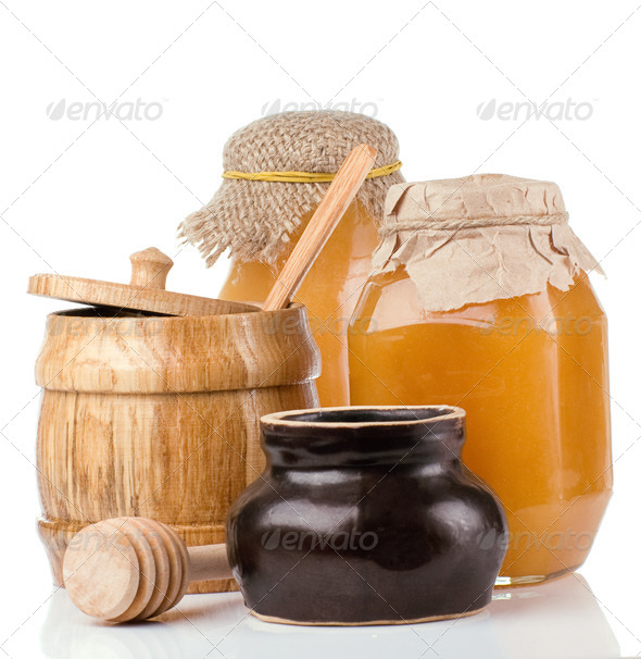 glass, ceramic and wooden jars full of honey - Stock Photo - Images