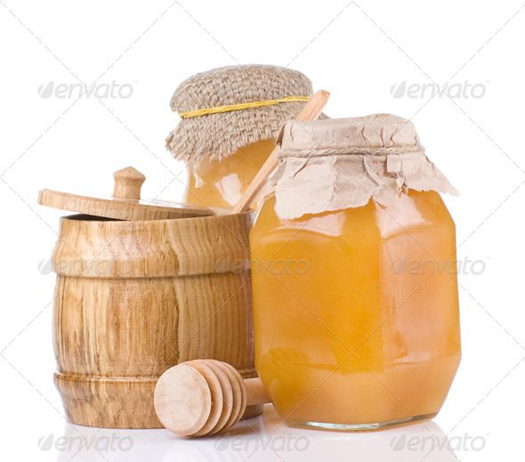 jars and pot full of honey isolated on white - Stock Photo - Images