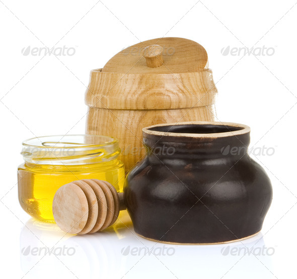 jars and pot of honey isolated on white - Stock Photo - Images