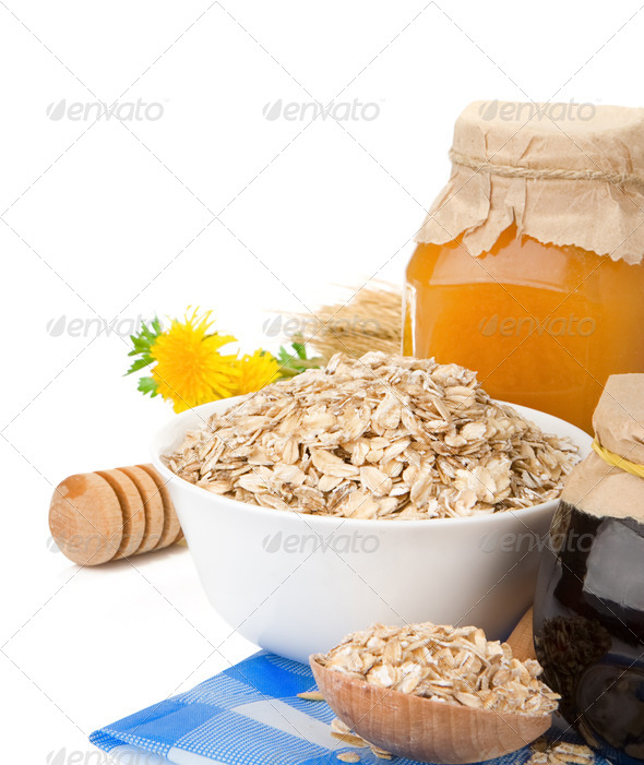 cereals with honey and oatmeal isolated on white - Stock Photo - Images