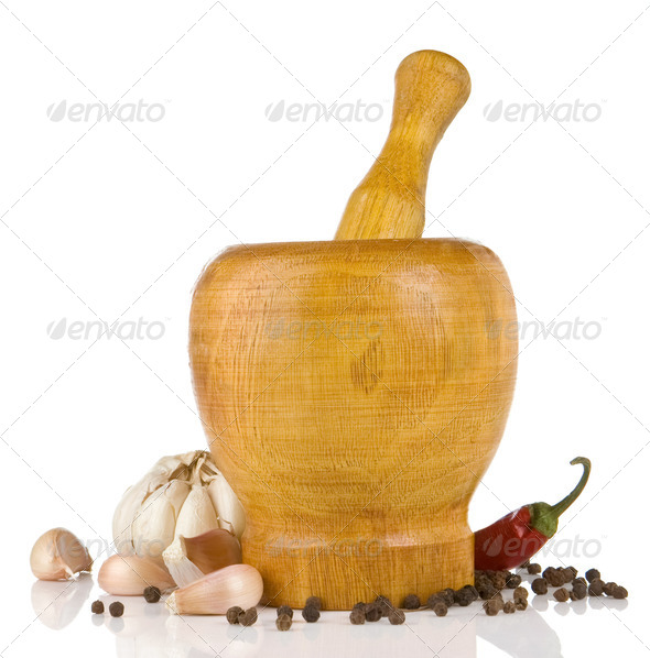 garlic, pepper in mortar and pestle on white - Stock Photo - Images