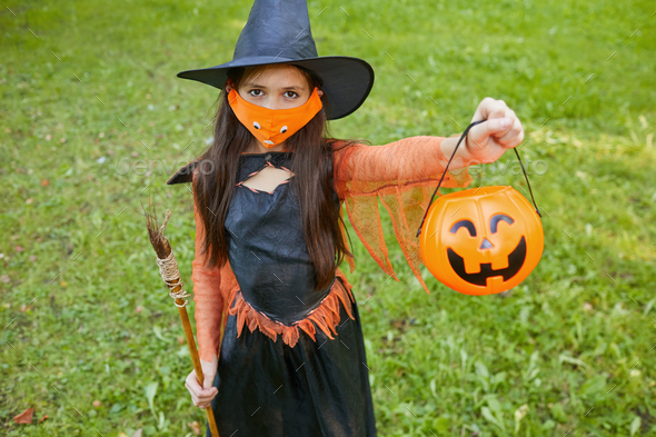 Little witch outdoors - Stock Photo - Images
