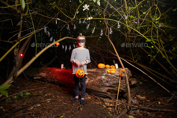 Girl standing in the dark forest - Stock Photo - Images