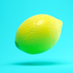 Flying lemon on blue background 3 D illustration - PhotoDune Item for Sale