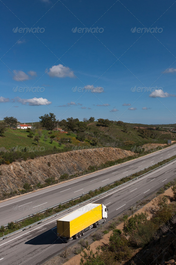 view of motorway with yellow truck - Stock Photo - Images