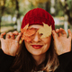 Portrait of smiling woman in red hat with orange leaves. Season and autumn holiday. - PhotoDune Item for Sale