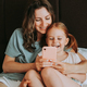 Mother and her daughter use smartphone - PhotoDune Item for Sale