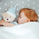 Little baby girl sleeping with her bear toy. - PhotoDune Item for Sale