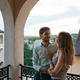 Portrait couple hugging on balcony - PhotoDune Item for Sale