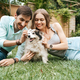 Beautiful couple with a dog on the grass - PhotoDune Item for Sale