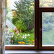 view of ornamental garden with well through window - PhotoDune Item for Sale