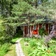 wood country house in overgrown ornamental garden - PhotoDune Item for Sale