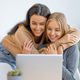 two happy young women using laptop - PhotoDune Item for Sale