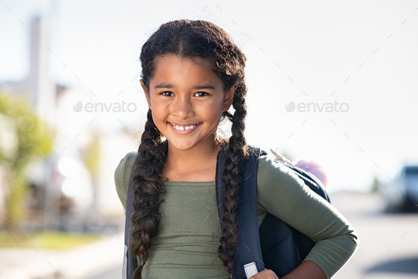 Smiling elementary school girl with bagpack - Stock Photo - Images