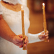Godmother and father hold candles in church during baby baptism - PhotoDune Item for Sale