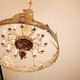 A large, beautiful chandelier with many expensive stones hangs on the ceiling in a church - PhotoDune Item for Sale