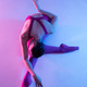 Young and graceful ballet dancer isolated on purple studio background in neon light - PhotoDune Item for Sale