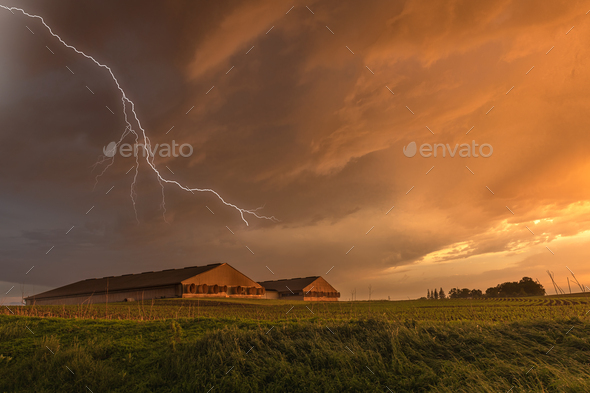 Lightning over grain storage facilities - Stock Photo - Images