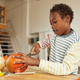 Boy Carving Pumpkin For Halloween - PhotoDune Item for Sale