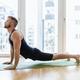 Man practicing yoga at his home - PhotoDune Item for Sale