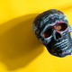Human skull on a yellow background with shadow. - PhotoDune Item for Sale