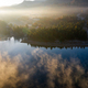Lovely autumnal landscape with fog over the lake. - PhotoDune Item for Sale