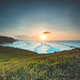 Indonesia ocean sunrise, green cliff beach nobody nature landscape with greenery grass at clear sky - PhotoDune Item for Sale
