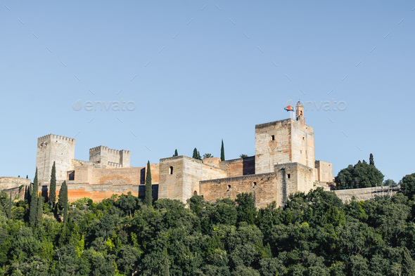 View of the Alhambra Palace from the Carvajales viewpoint. Blue sky for copy space or collage - Stock Photo - Images
