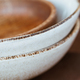 Macro abstract photography of modern minimalist ceramics set and wooden bowl - PhotoDune Item for Sale