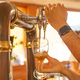 Hands of a bartender serving a beer tap to a cup - PhotoDune Item for Sale