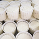 Ricotta cheese in plastic molds on cheese factory in Italy - PhotoDune Item for Sale