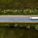 Large freight transporter semi-truck on the road, aerial view - PhotoDune Item for Sale