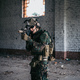 Military soldier in the form holds in the hands an assault rifle, check possible enemies around the - PhotoDune Item for Sale