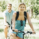 Young couple riding bicycle in park - PhotoDune Item for Sale
