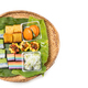 Overhead view of assorted nyonya kueh on banana leaf rattan tray - PhotoDune Item for Sale