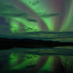 Dramatic Northern Lights calm lake mirrored - PhotoDune Item for Sale
