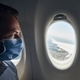 Man wearing face mask inside airplane - PhotoDune Item for Sale