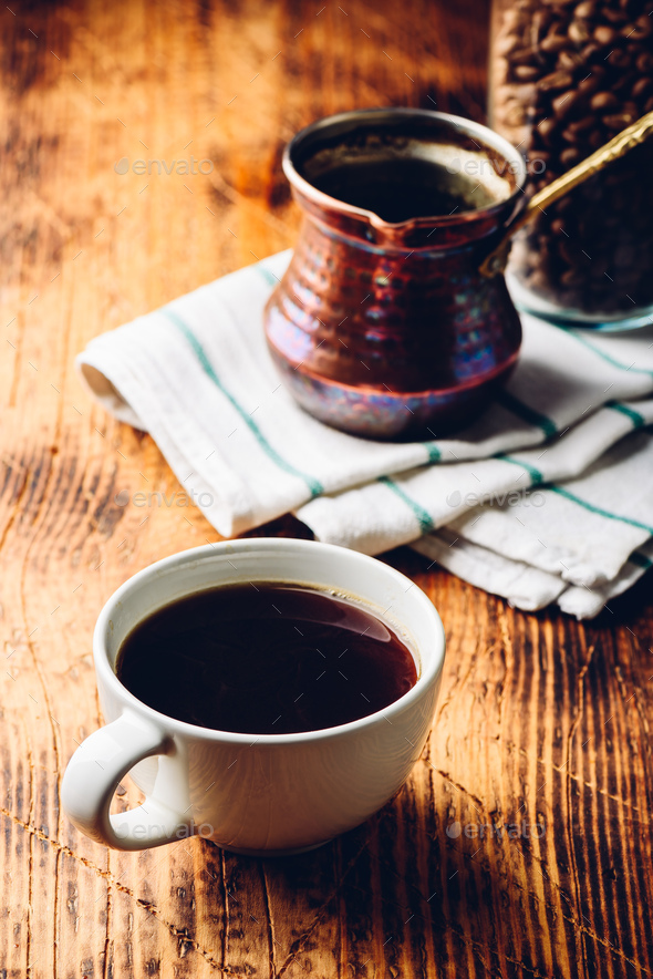 Cup of black coffee on wooden table - Stock Photo - Images
