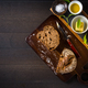 Tuna spread with fresh bread slice, sage butter, olive oil and salt on rustic wooden table - PhotoDune Item for Sale
