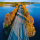 Aerial view of road and forest in autumn colors with blue water lake. - PhotoDune Item for Sale