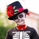 Cute smiling schoolboy with painted face in halloween costume of skeleton - PhotoDune Item for Sale