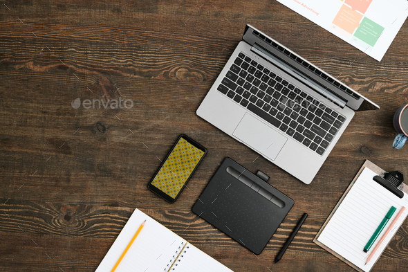 Flat layout of mobile gadgets, drink, open notebook with pencil and other stuff - Stock Photo - Images