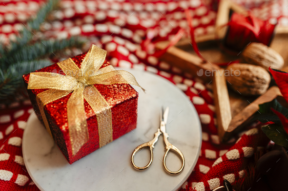 Christmas themed gift box with pine branches - Stock Photo - Images