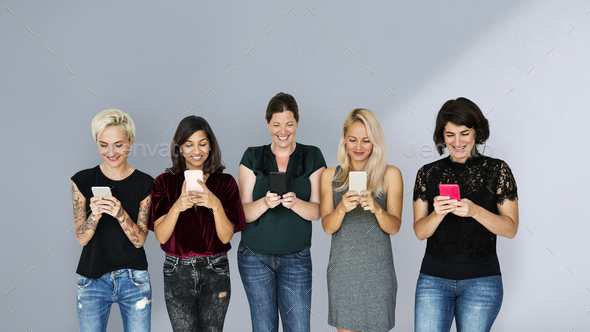 Group of women texting on their phones - Stock Photo - Images