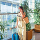Young tourist woman in medical mask in international airport - PhotoDune Item for Sale