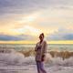 Woman on the beach enjoying summer holidays - PhotoDune Item for Sale