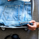 Hands of unrecognisable man packing his casual jeans, shirts in suitcase for travel - PhotoDune Item for Sale